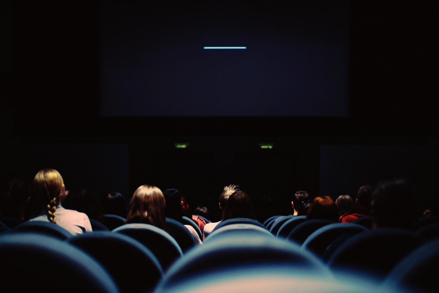 Photo: Modern moviegoers suffer in the theater.  Labeled for reuse by Erik Witsoe on Unsplash