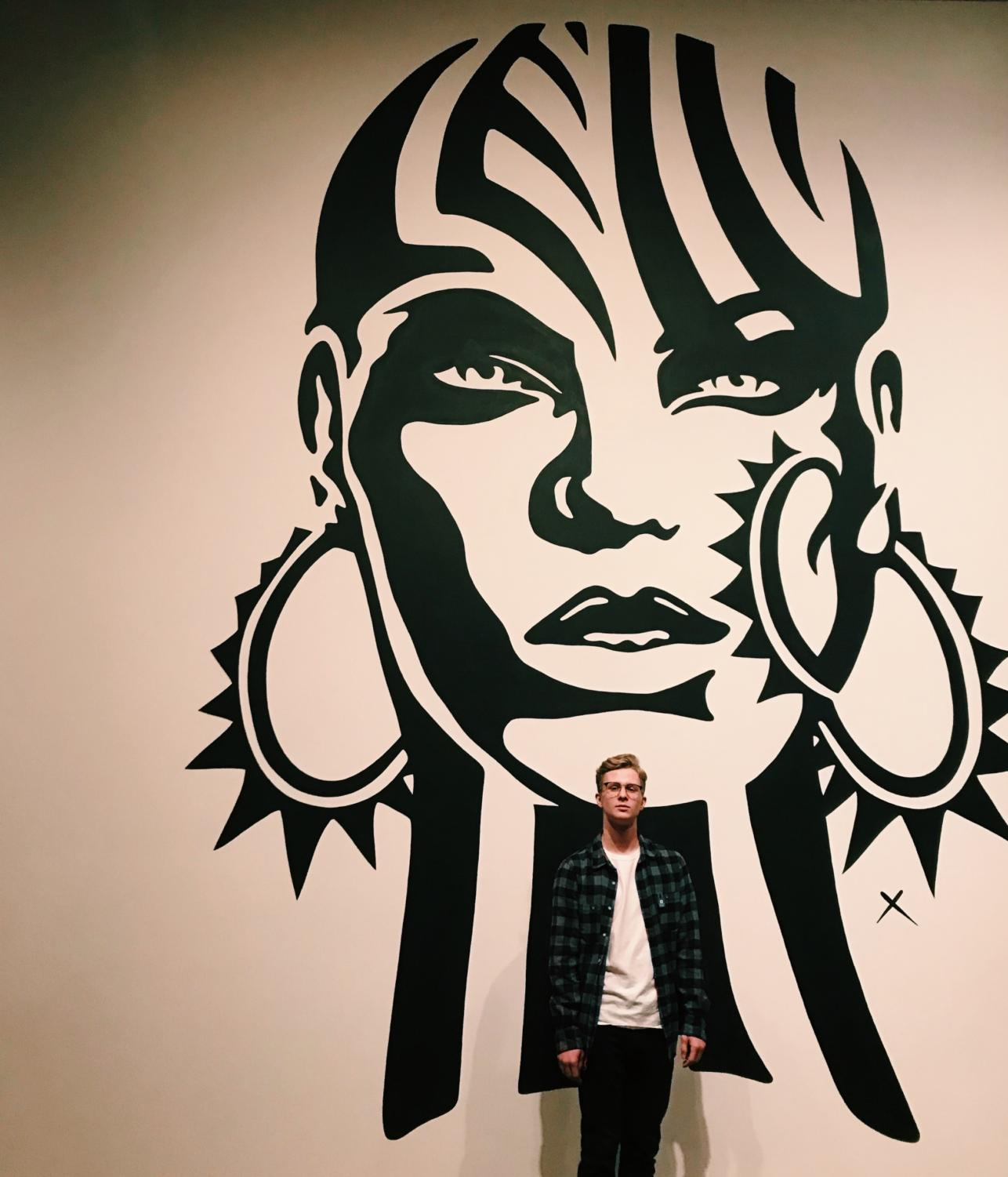 Snapshot Contest Winner Junior Alahna Esp takes a picture of junior Austin Kloss in front of a beautiful art piece while they were at the Denver Fine Arts Center on January 2nd, 2019
