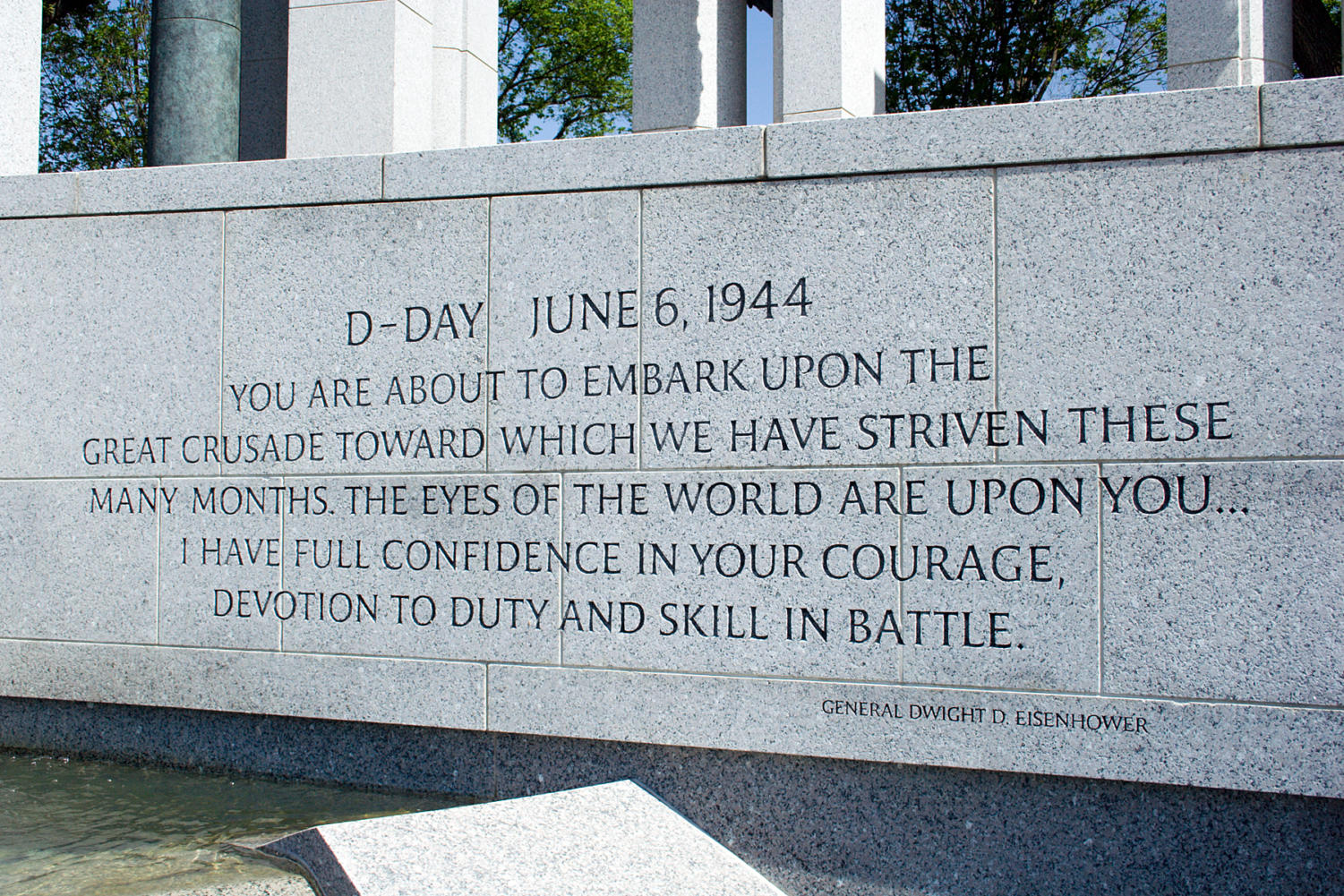 A stone wall at the World War ll Memorial, which has Dwight D. Eisenhower quote. (Labled for reuse).