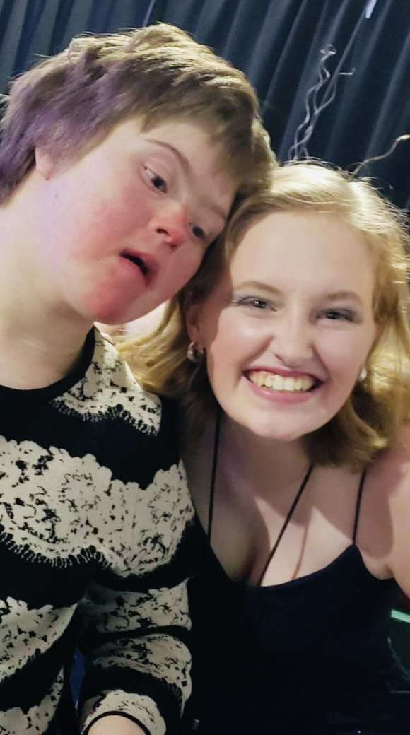 Snapshot Contest Winner Junior Hannah Harper as a volunteer at a Night to Shine, a prom for people with special needs, and her buddy Laura on February 8, 2019