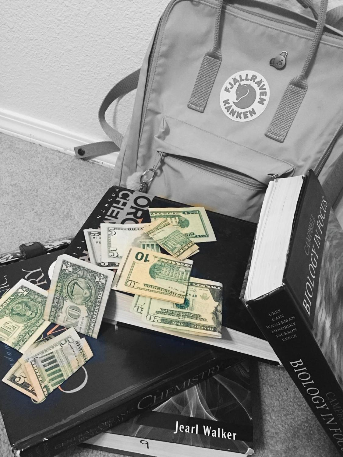 The necessities for college: a backpack, textbooks and a lot of cash.