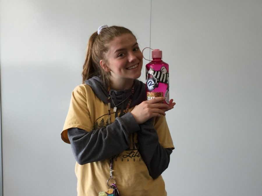 AAHS junior Maizie Daye flexes her stickered water bottle.