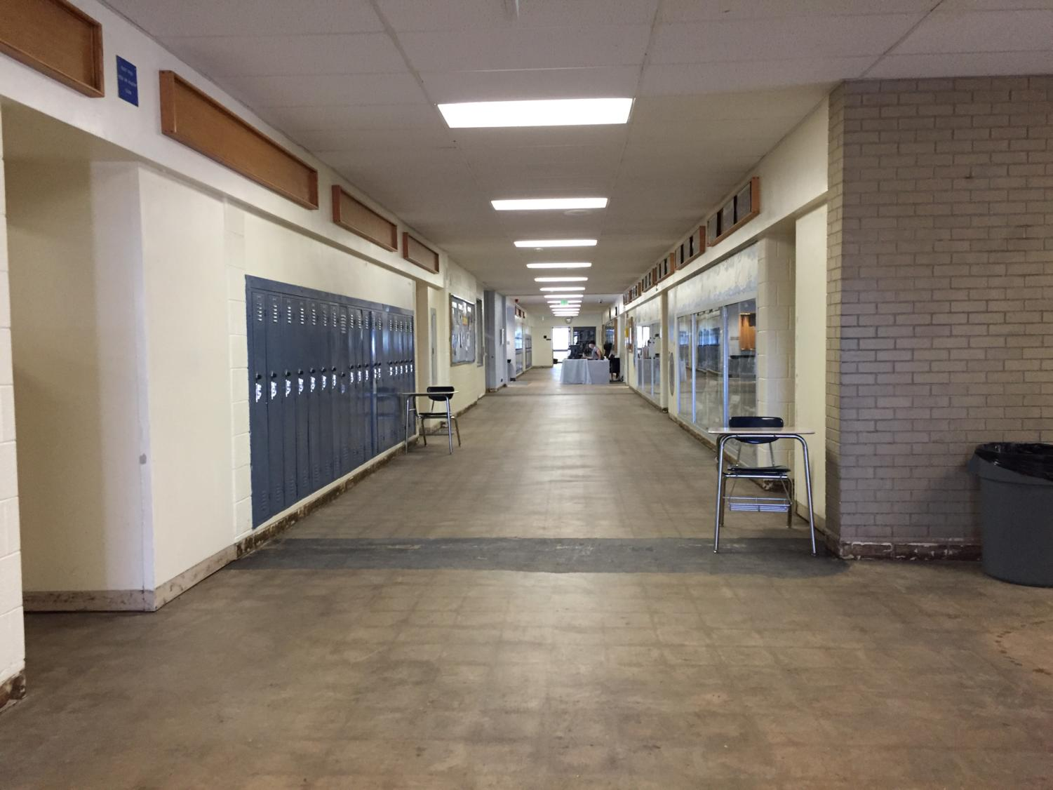 A building in Air Academy High School remains without proper flooring, for now.