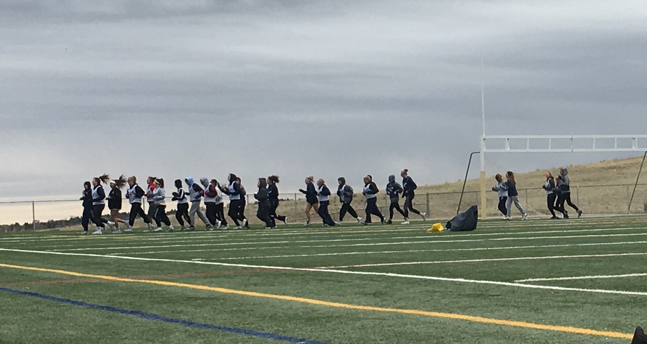 Varsity Girls Lacrosse warming up for practice on their last week of the regular season.