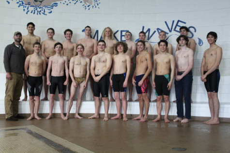 The AAHS boys swim team poses for team photo.