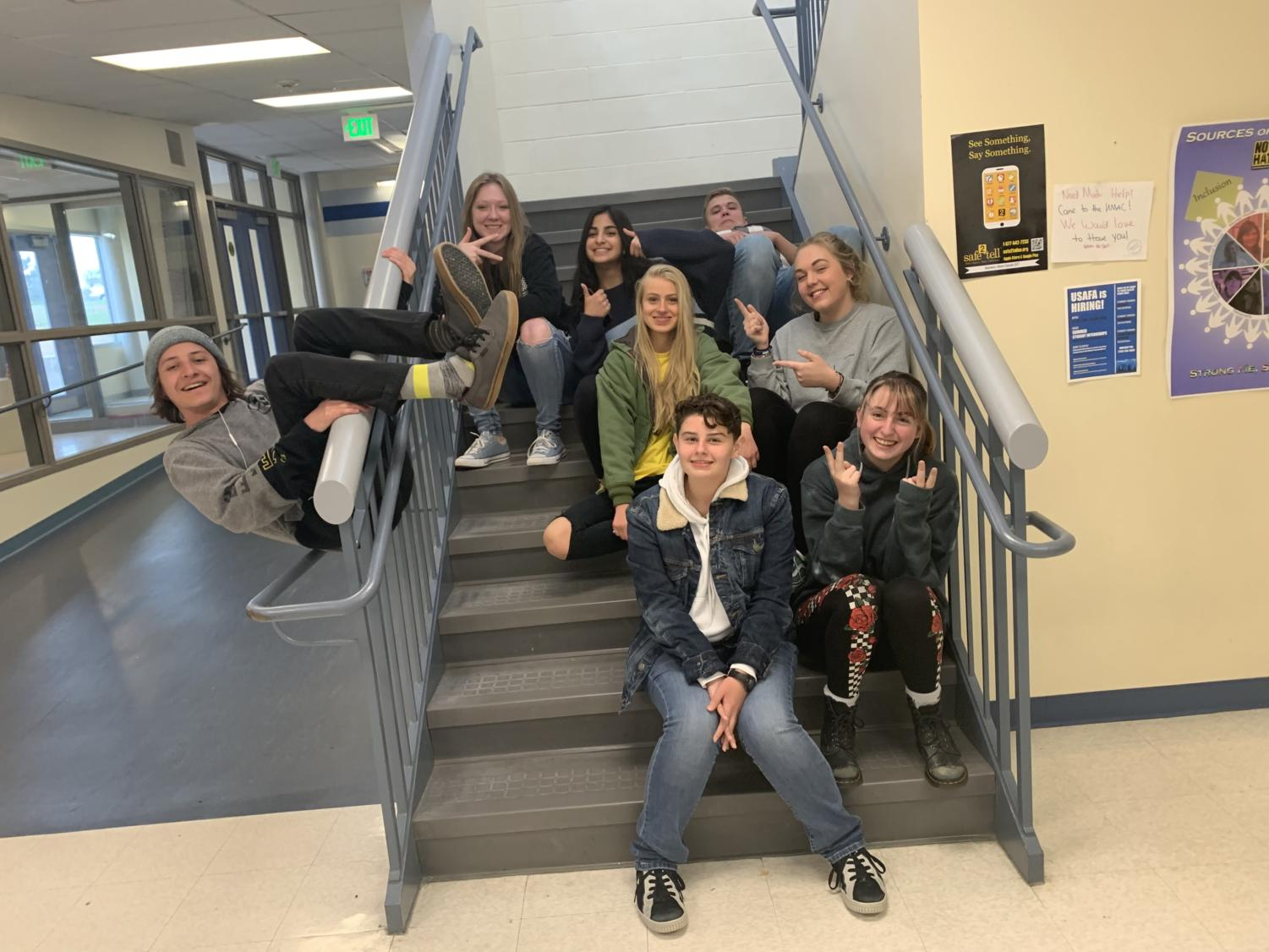 The non-senior Jetstream Staff poses for a personality pic on the famous office stairs.