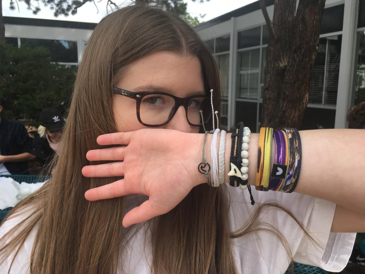 Senior Anna Zapel shows off her many different bracelets.