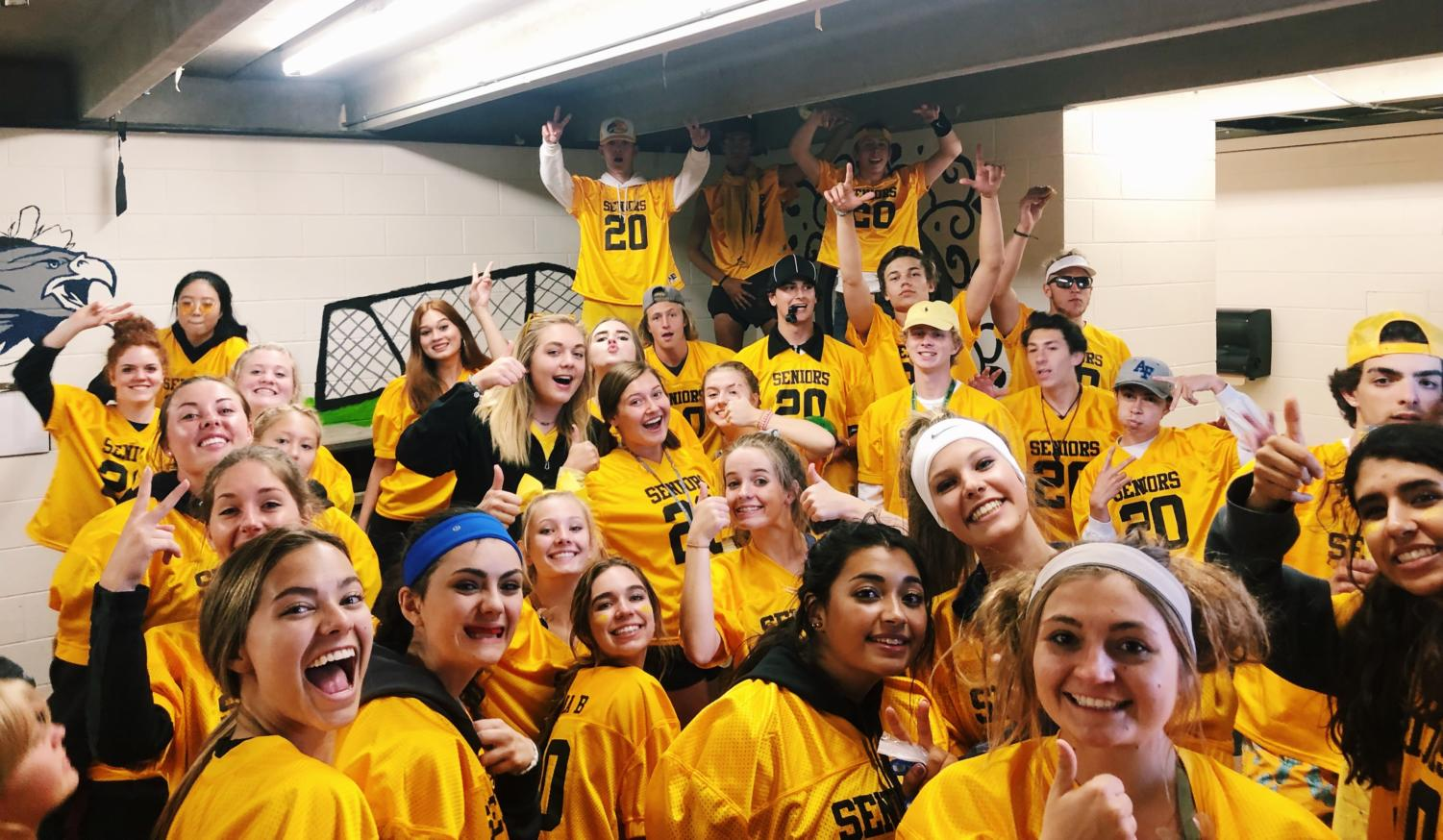Senior students gathered in the outdoor locker room getting pumped for the Powderpuff game.