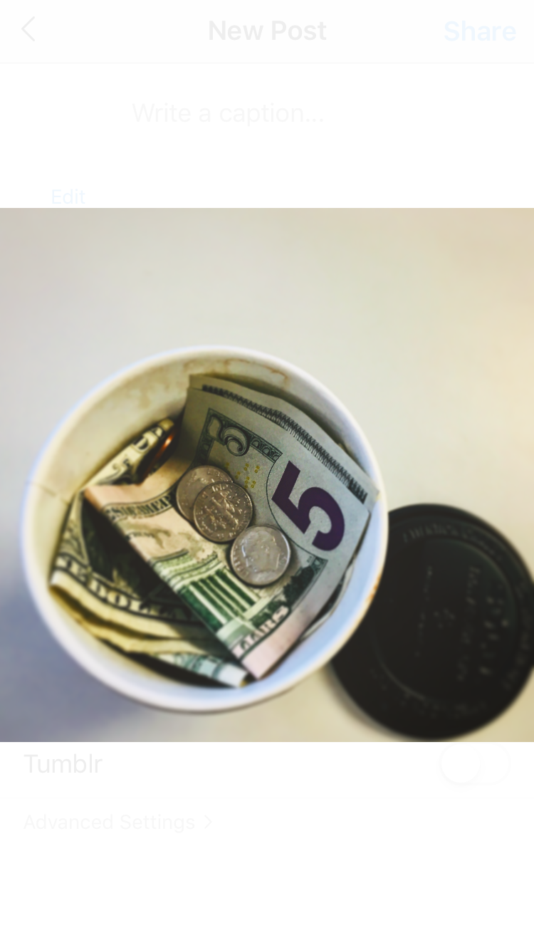 A Coffee cup full of money representing how much students spend on Coffee.