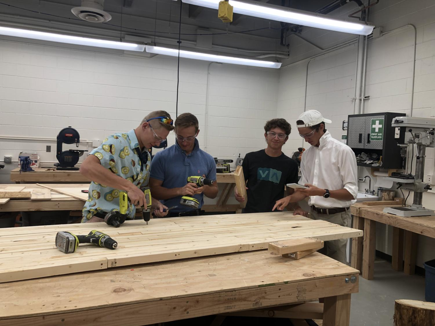 Tyler L'Hotta, Ryan O'Connor, Toby Ubben, Justin Banta working in second period engineering class.