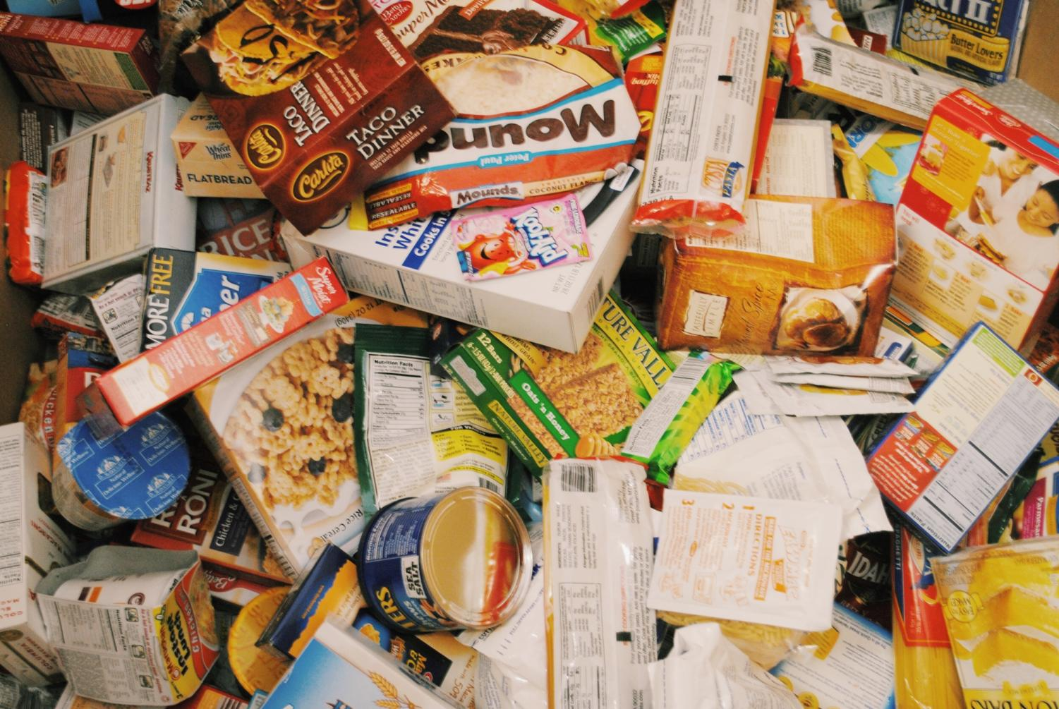 Piles of cans and non-perishable foods will be donated to Harvest of Love this week.