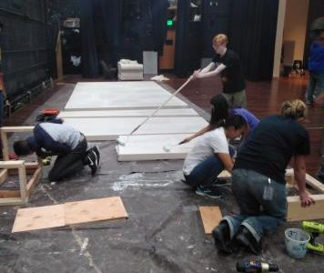 The Air Academy High School theater tech works hard on building the set for their next production of Shakespeare's