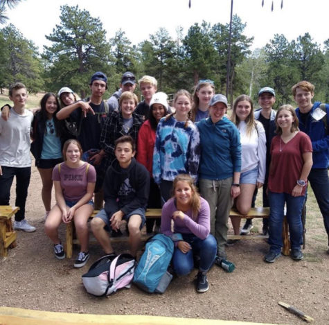 Nate Riggs poses for a photo alongside other counselors from across District 20 for the 2018 High Trails trip. Photo taken by senior, Nate Riggs.