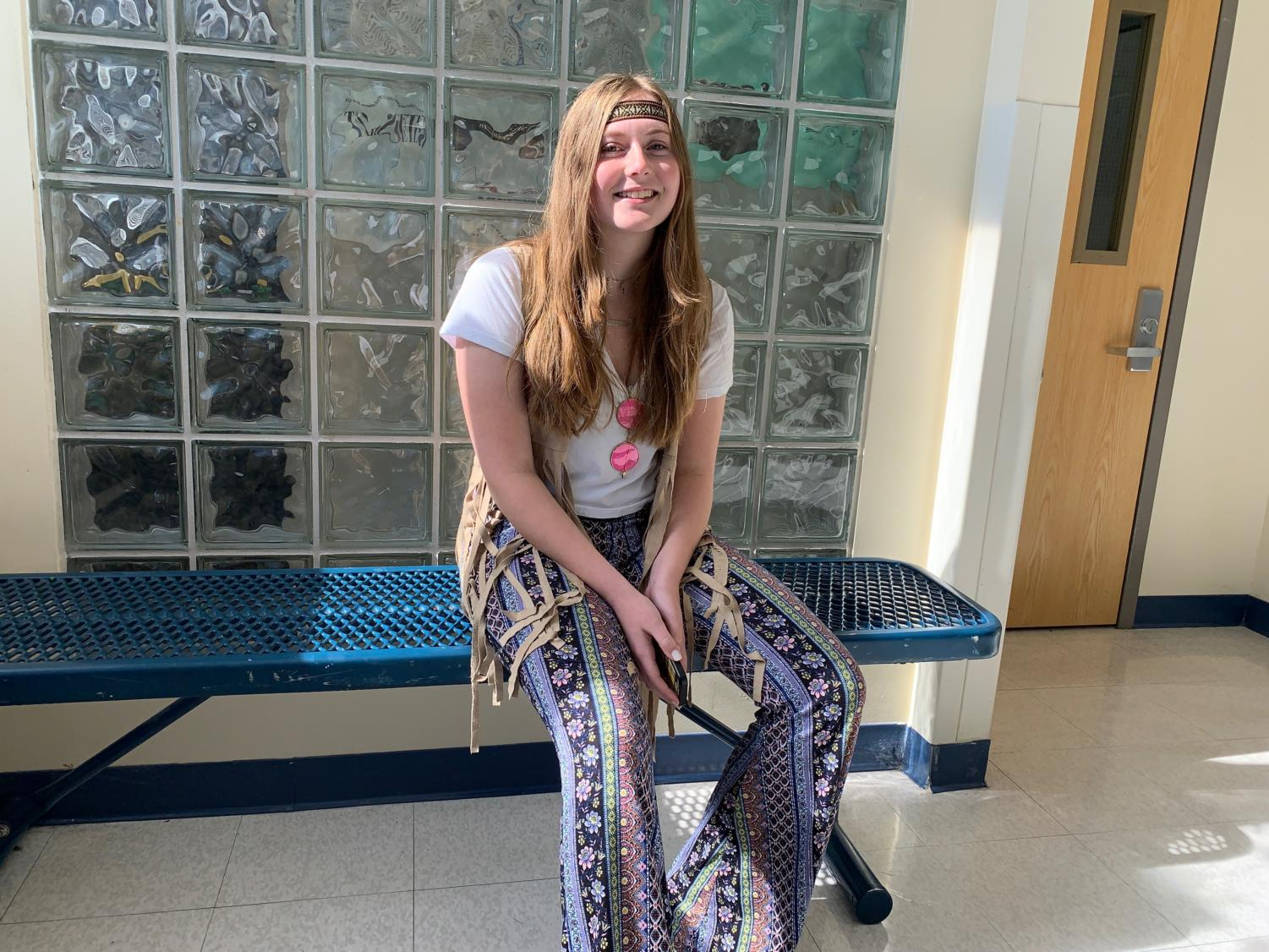Junior Abby Bowers dresses up as a hippie for Halloween.