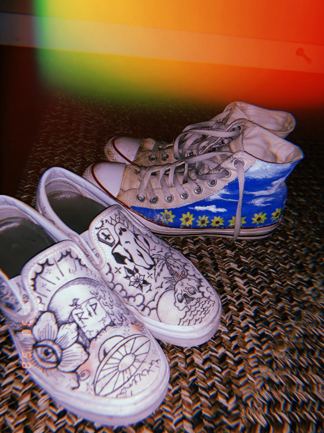 White slip-on vans and hightop converse were used as canvases for seniors Austin Kloss and Lana Meyer.