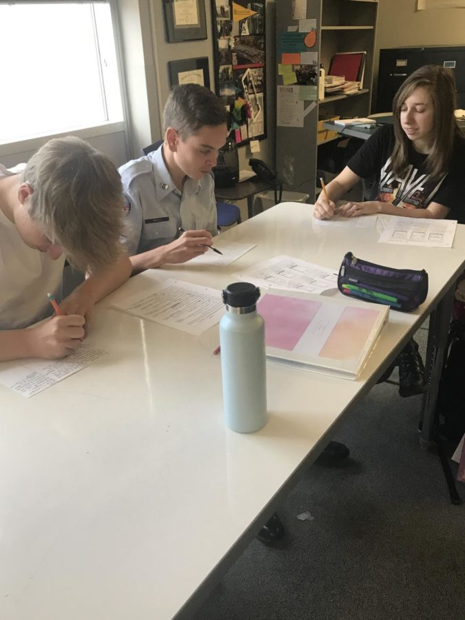 Air Academy Spanish 2 students sophomores Jackson McLaughlin, Mason Birch, and freshman Riley Whitelaw work on a personal paragraph in Mrs. Orr's class