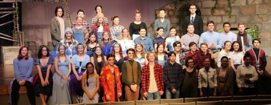 The AAHS theater cast stands on set of their last production, A Midsummer Nights Dream.
