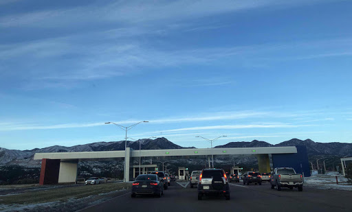 A line of cars waits to enter the southern gate of the Air Force Academy on a December morning.