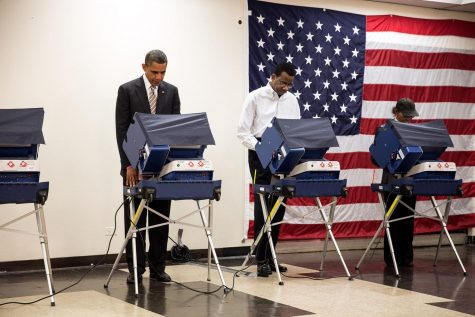 Barack Obama votes before his election in 2012. Labeled for reuse by Wikimedia Commons.