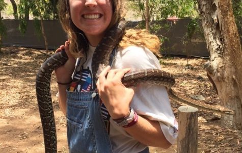 Air Academy graduate Julia Helle poses with a snake during her gap year in Australia.