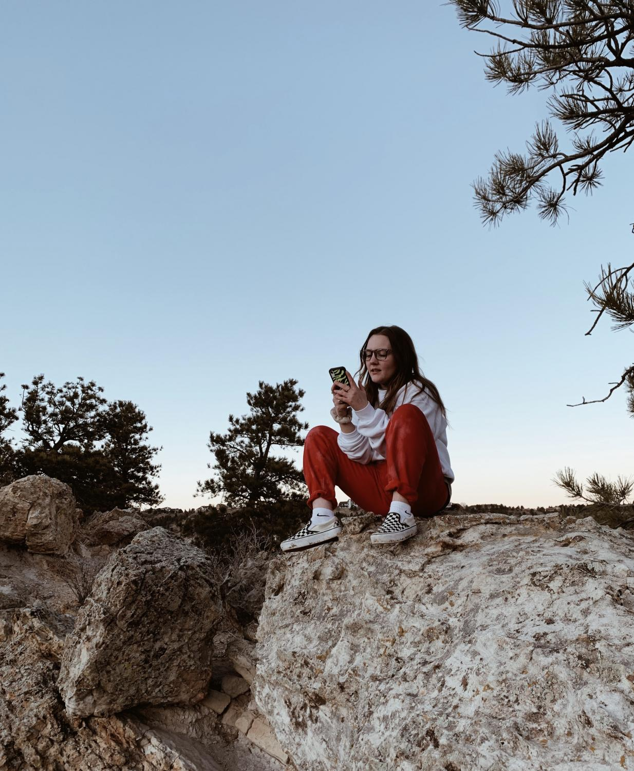 "Senior Sydney Pruitt ""explores"" Ute Valley while watching the sunset."