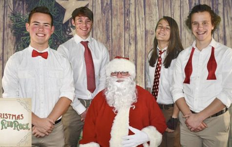 Band members (from left to right), Ben Hellem, Brendan Young, Cohen Kyle, and Jackson Berry pose with Santa during the Christmas season.