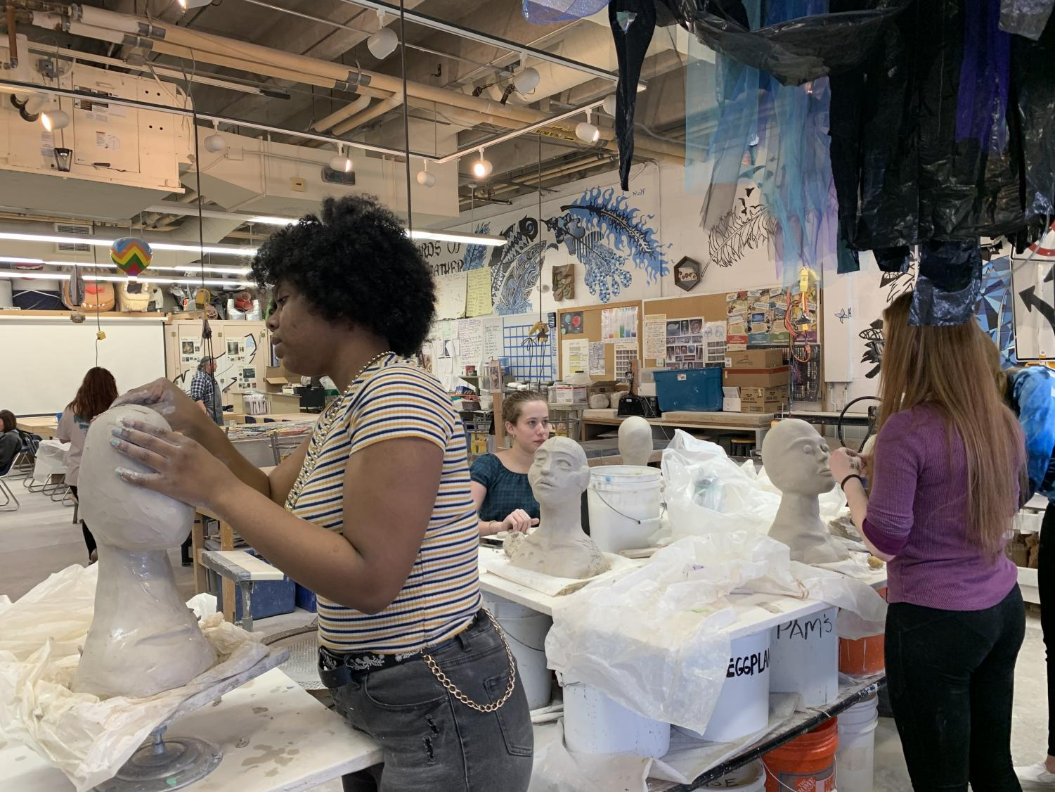 Sophomore Abeni Nelson works hard on her newest ceramics project.