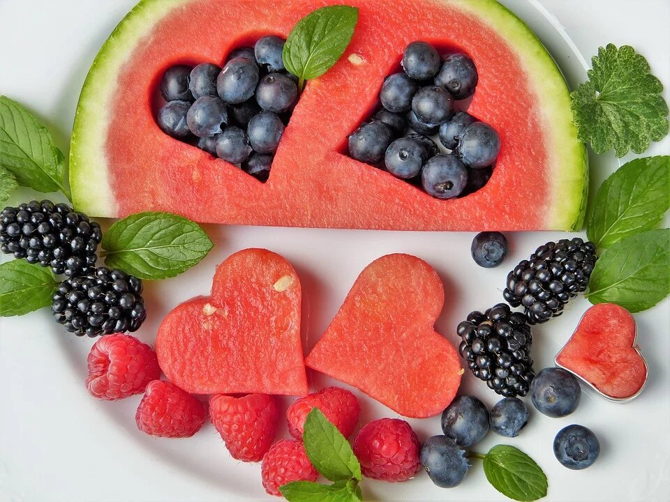 Many people cut fruit into shapes to celebrate Valentine's Day. Labeled for reuse by Pixabay.