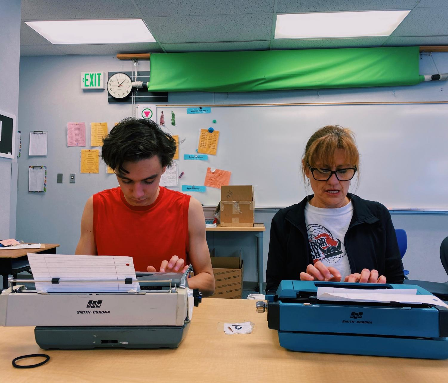 enior Aiden Chesmore and English teacher Mary Anderson spending journalism class on February 28th the old-fashioned way on their typewriters.