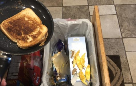 Sophomore Lizzy Dalton dumps a grilled cheese sandwich in the trash.