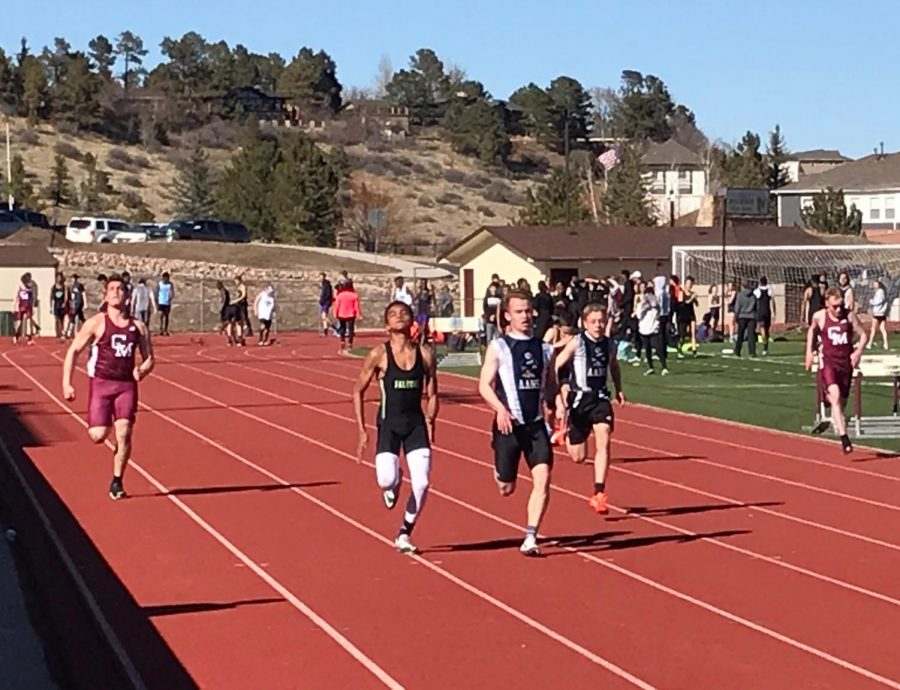 AAHS athletes Sam Hutton and Peter Braza battle in the 100 meter dash at a 2019 Cheyenne Mountain High School track meet.