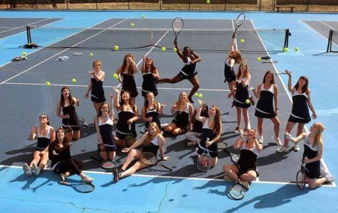 The 2019 Women's JV Tennis Team takes their team photo.