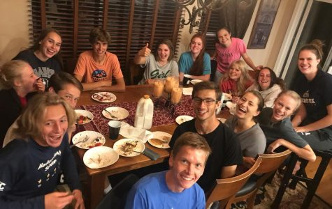 Seniors Emily Gregerson, Ethan Abbs, Ruthie Evilsizer, Hope Crawford-Guanera, Mary Waterman, Gabriella Robinson, Molly Matheson, Olivia Jacobsen, Michealla Hein, Abby Cole, Matthew Mettler, Matthew Storer, Dylan Harley, Justin Banta, and Gabrielle Young all gather after Homecoming dance at Abby Cole's house for late-night pancake dinner.