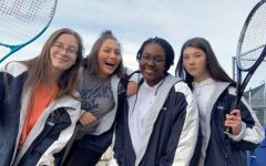 [Left to Right] Savannah Huyveart, Alyssa Martin, Ashlyn Johnson and Lydia McCann pose for a picture after Tennis practice at Air Academy High School.