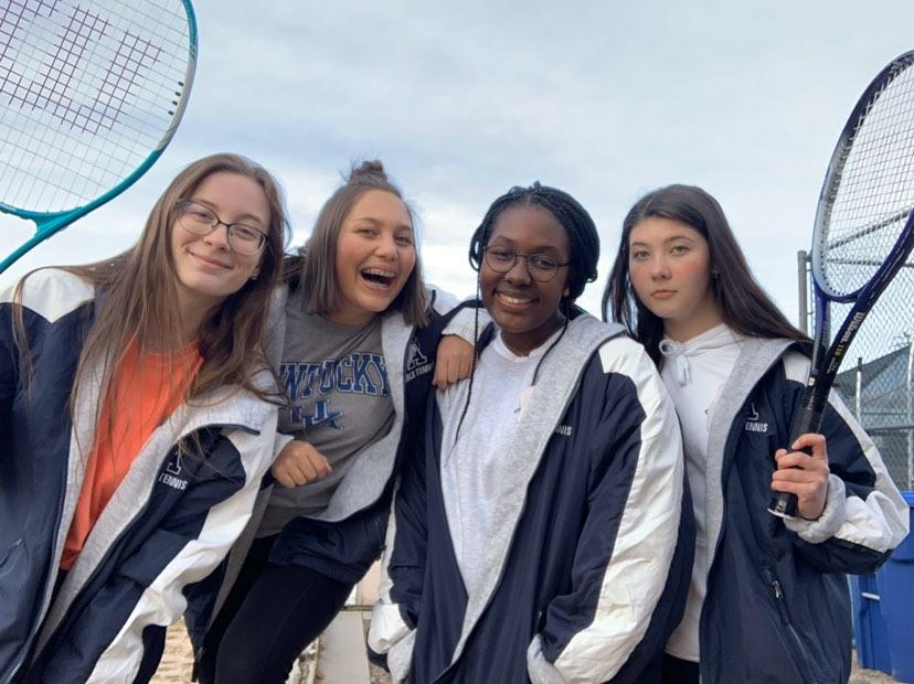 %5BLeft+to+Right%5D+Savannah+Huyveart%2C+Alyssa+Martin%2C+Ashlyn+Johnson+and+Lydia+McCann+pose+for+a+picture+after+Tennis+practice+at+Air+Academy+High+School.