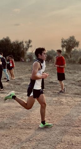Senior Drew Braden briskly runs by during a cross country race held in Fountain Creek Regional Park.