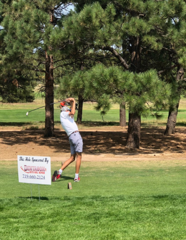 Senior Zachary Iaconis takes a smooth swing off the tee box on Air Academy High School