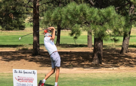 Senior Zachary Iaconis takes a smooth swing off the tee box on Air Academy High School's home course on the Air Force Academy,  Eisenhower Golf Course.