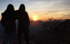 Junior Mia Belmear and her cousin watch the sunset atop the Grand Canyon.