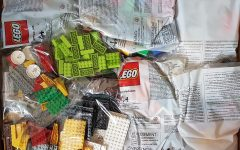 Labeled for reuse by Creative Commons license. LEGOS are shown as they are being unpackaged.