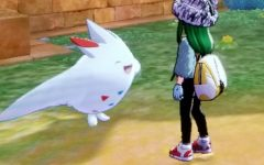 Emerald Peakes' Pokemon character interacts with a Togekiss, named Toby.