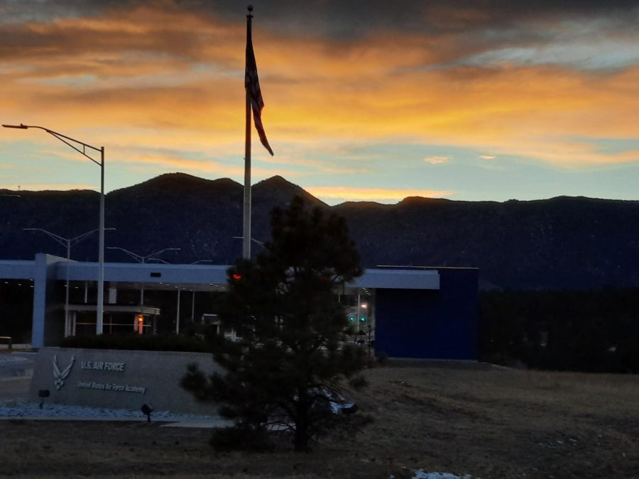 Photo by science teacher Brad Boyle. The sun sets over the American flag at the entrance of the United States Air Force Academy.