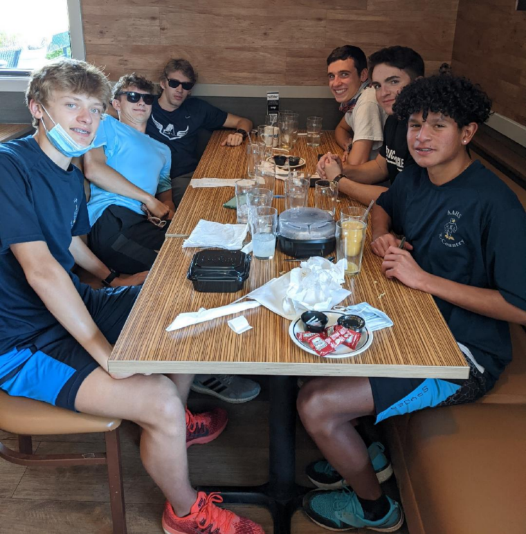 Air Academy Varsity Cross Country boys after demolishing a meal at IHOP right after the CHSAA regional race in Denver. Left to right: freshman Nate Lumaye, senior Ben Hodge, senior Alex Maline, senior Drew Braden, senior Sean O'Neil (not on the cross country team) and senior Ben Lumaye.