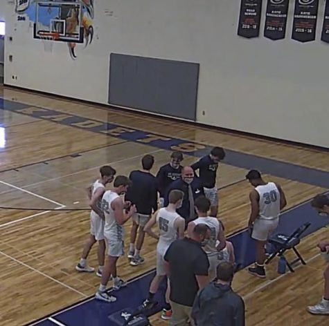 AAHS basketball players huddle while playing a victorious game against Coronado on January 30 2021. Photo Credit: Kadet Athletics.