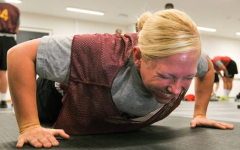 A women doing a push-up. Labeled for reuse on Creative Commons.
