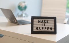 A sign showing make it happen. Labeled for reuse by Creative Commons.