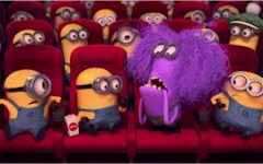 Labeled for reuse by Creative Commons.  Illumination Entertainment's Minions watching a movie at a cinema with red seats.