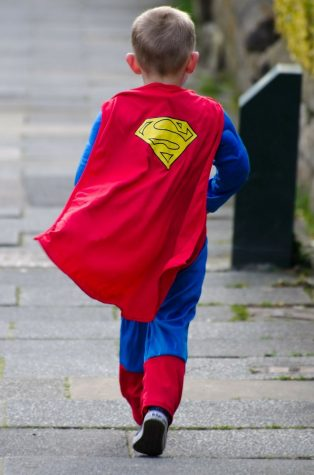 Photo labelled for reuse by pixabay. A child dresses up in a superman costume and imagines being a superhero with a power of his own.