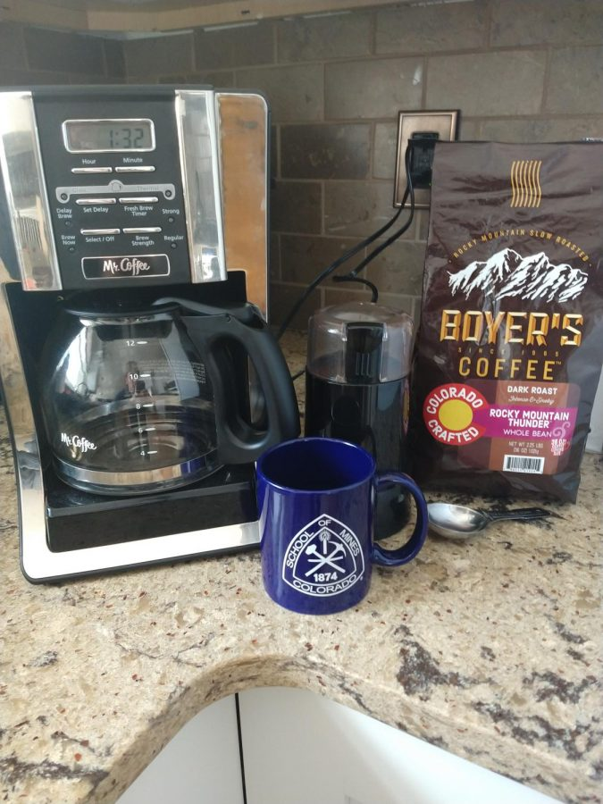 Alex Maline's Mr. Coffee drip coffee maker, Mr. Coffee blade grinder and Boyer's Rocky Mountain Thunder Dark Roast set up on display.