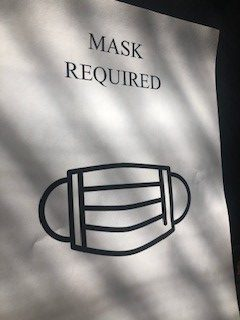 A paper poster demanding the use for masks. The mask mandate is a large part of the current COVID-19 restrictions in El Paso county.